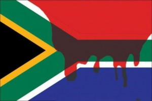 Marikana-mine-workers-blood-stains-South-African-flag.preview